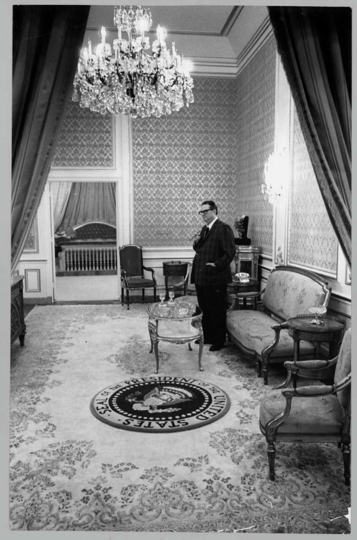 File Photo: 09/29/1968 -- Judge Roy Hofheinz stands in the 20-foot-ceilinged Presidential Suite at the Astrodome. The suite was across the elevator from Hofheinz own living quarters and had a rug bearing the Presidential seal. Baths were trimed in purple velvet and toilet handles were made of gold. The suite, without a view, was built behind the scoreboard for security reasons. Photo: Richard Pipes / Houston Chronicle