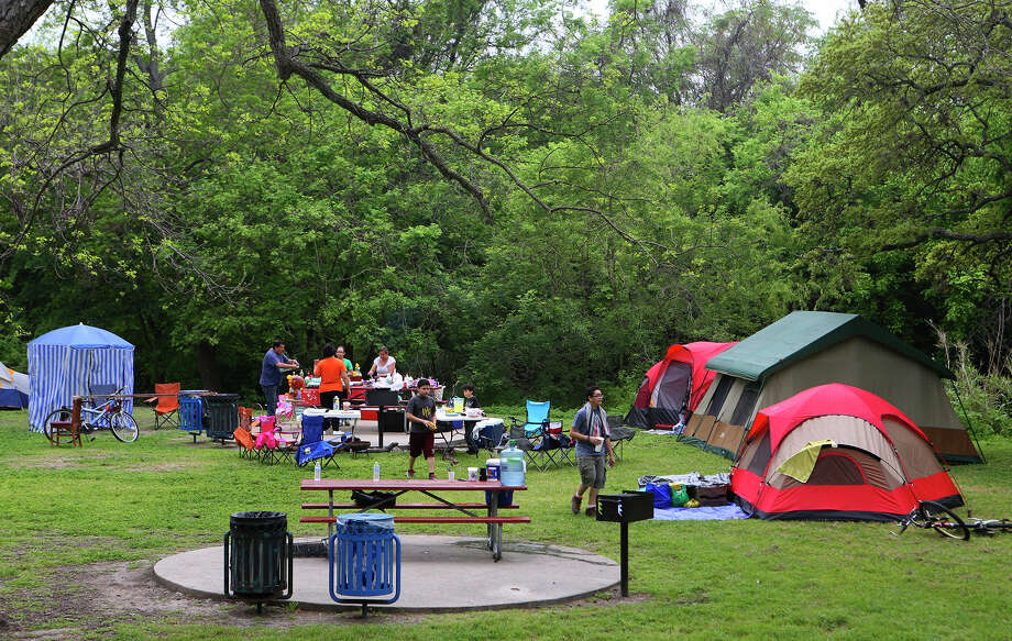 Campers get ready for Easter weekend Friday April 3, 2015 at Brackenridge Park. The curfew at the park was lifted Thursday night and will go back into effect at 11:00 p.m. Easter Sunday. Photo: John Davenport, San Antonio Express-News / ©San Antonio Express-News/John Davenport