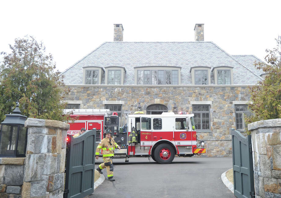 The scene of the aftermath of a fire at 44 Cutler Road in Greenwich, Conn., Friday afternoon, April 3, 2015. Deputy Fire Marshal Rob Natale said the fire started in the indoor pool area of the home and that it was quickly extinguished by Greenwich firefighters and that no one was injured. Photo: Bob Luckey / Greenwich Time