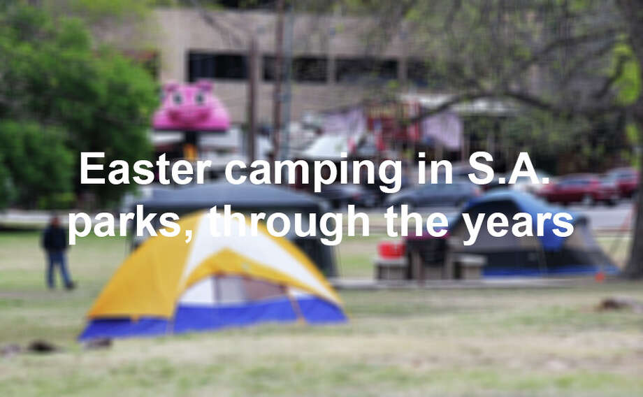 Camp sites start to pop up around Brackenridge Park on Thursday, Mar. 28, 2013. Campers were slowly making their arrival to the park either in person or by placing chained chairs near spots where they hope to spend Easter weekend with family. The city officially lifted the overnight curfew so that campers can celebrate the holiday over the weekend without having to leave the park. Photo: Kin Man Hui, San Antonio Express-News / © 2012 San Antonio Express-News