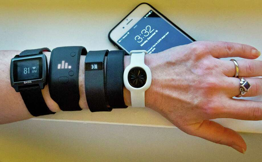 Fitness trackers attempt to make exercise more entertaining, but the data overload can be daunting. Photo: Bebeto Matthews, STF / AP