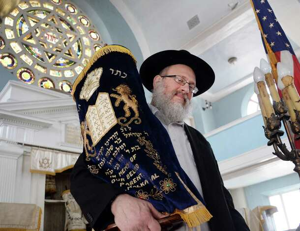 Rabbi Laibel Morrison takes down the Torah in the main sanctuary of the historic Beth Tephilah in preparation for the upcoming Passover holiday Friday April 3, 2015 in Troy, NY.  (John Carl D'Annibale / Times Union) Photo: John Carl D'Annibale / 00031299A