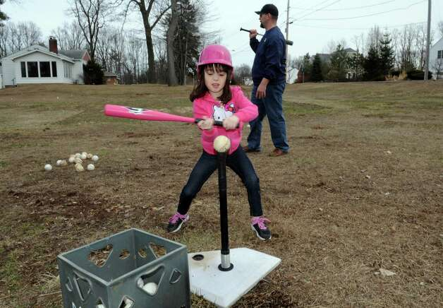 Five-year-old Madison Mailloux and her father Josh Mailloux hit baseballs  on Friday April 3, 2015 in Colonie, N.Y. (Michael P. Farrell/Times Union) Photo: Michael P. Farrell