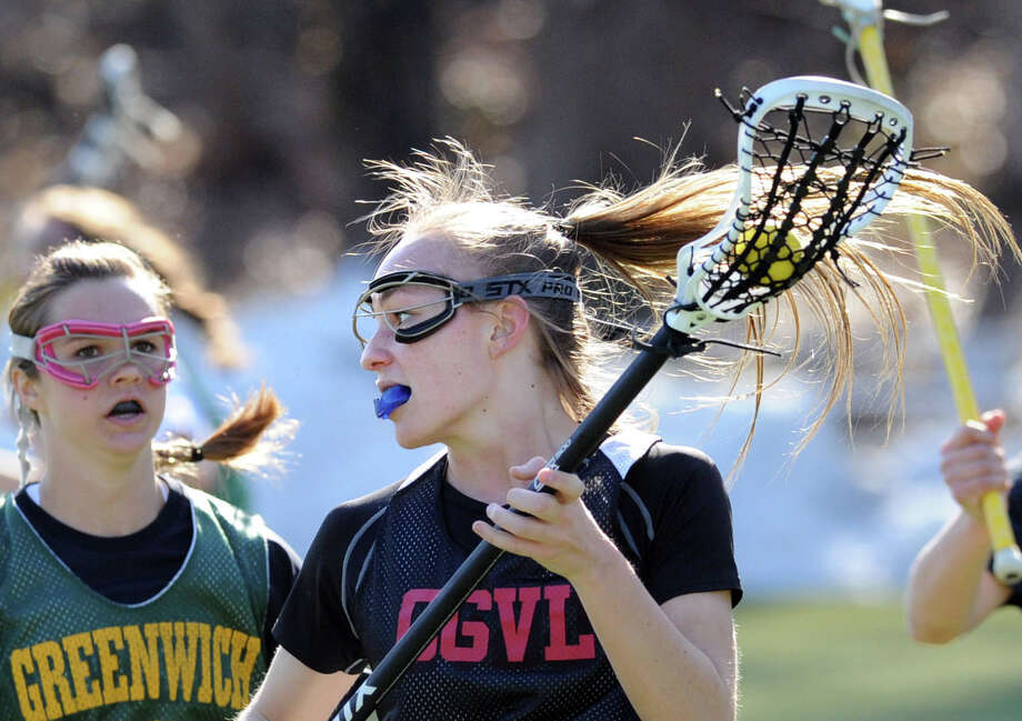 At center, Anne Dunster of Greenwich High School during the girls high school lacrosse scrimmage against Greenwich Academy at Greenwich Academy, Thursday, April 2, 2015. Photo: Bob Luckey / Greenwich Time