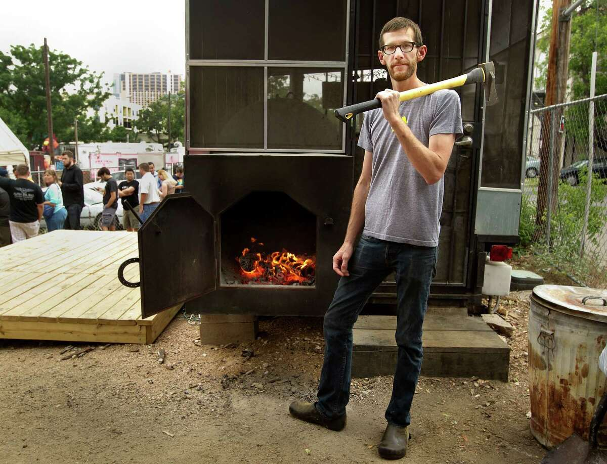 John Lewis is the pit master at La Barbecue in Austin, Texas. A line has formed in the background, waiting for La Barbecue to open for the day.
