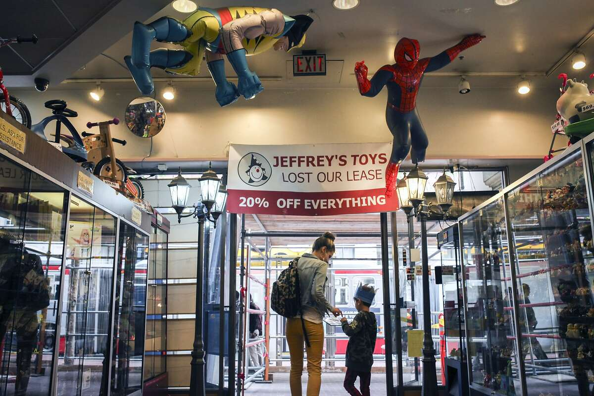 Ethan Marshall and Kylee Fournier leave Jeffrey's Toys on Market street in San Francisco after a vista on March 27th 2015. Jeffrey's Toys recently lost its lease and is looking for a new location.