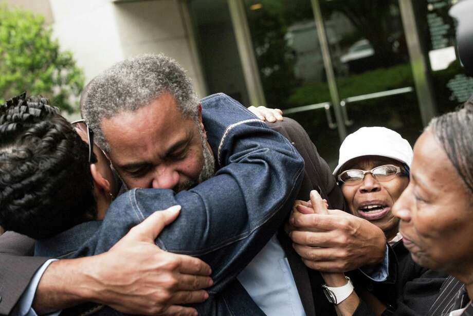 "Ray Hinton embraces supporters after his release in Birmingham. ""He was convicted because he was poor,"" said his lawyer, Bryan Stevenson. Photo: BOB MILLER / New York Times / NYTNS"