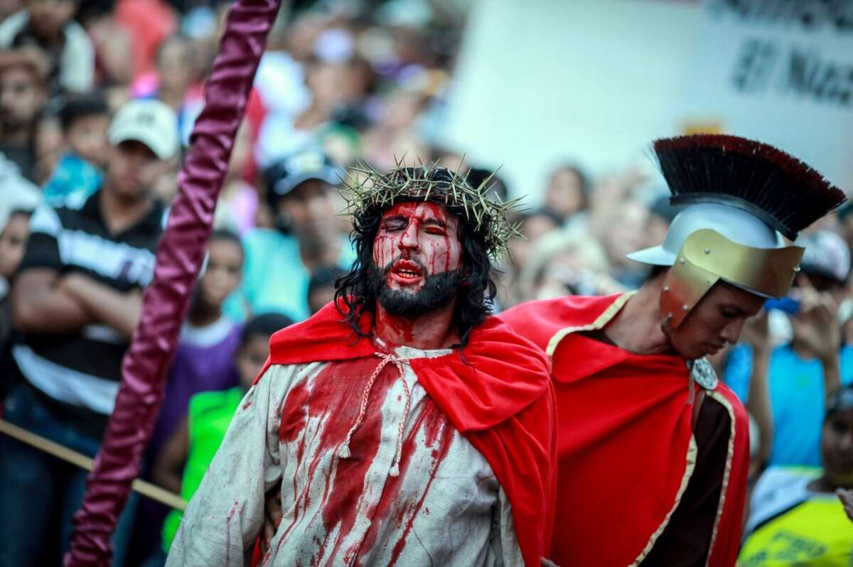 VenezuelaCatholic pop.: 24,815,000 A Catholic devotee portrays Jesus Christ in a re-enactment of the Good Friday procession during Holy Week in the Petare shantytown of Caracas.