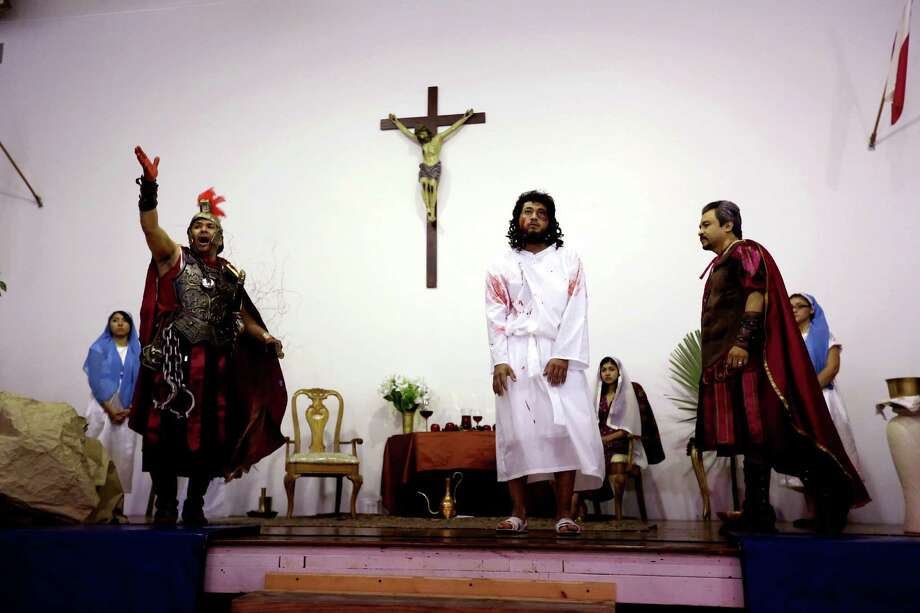Jorge Martinez, as Christ, is presented to Pontius Pilate as parishioners portray the Passion of Christ, the short final period in the life of Jesus covering his visit to Jerusalem and leading to his execution by crucifixion, at Queen of Peace Catholic Church on Good Friday, April 3, 2015, in Houston, Texas. Photo: Gary Coronado, Houston Chronicle / © 2015 Houston Chronicle