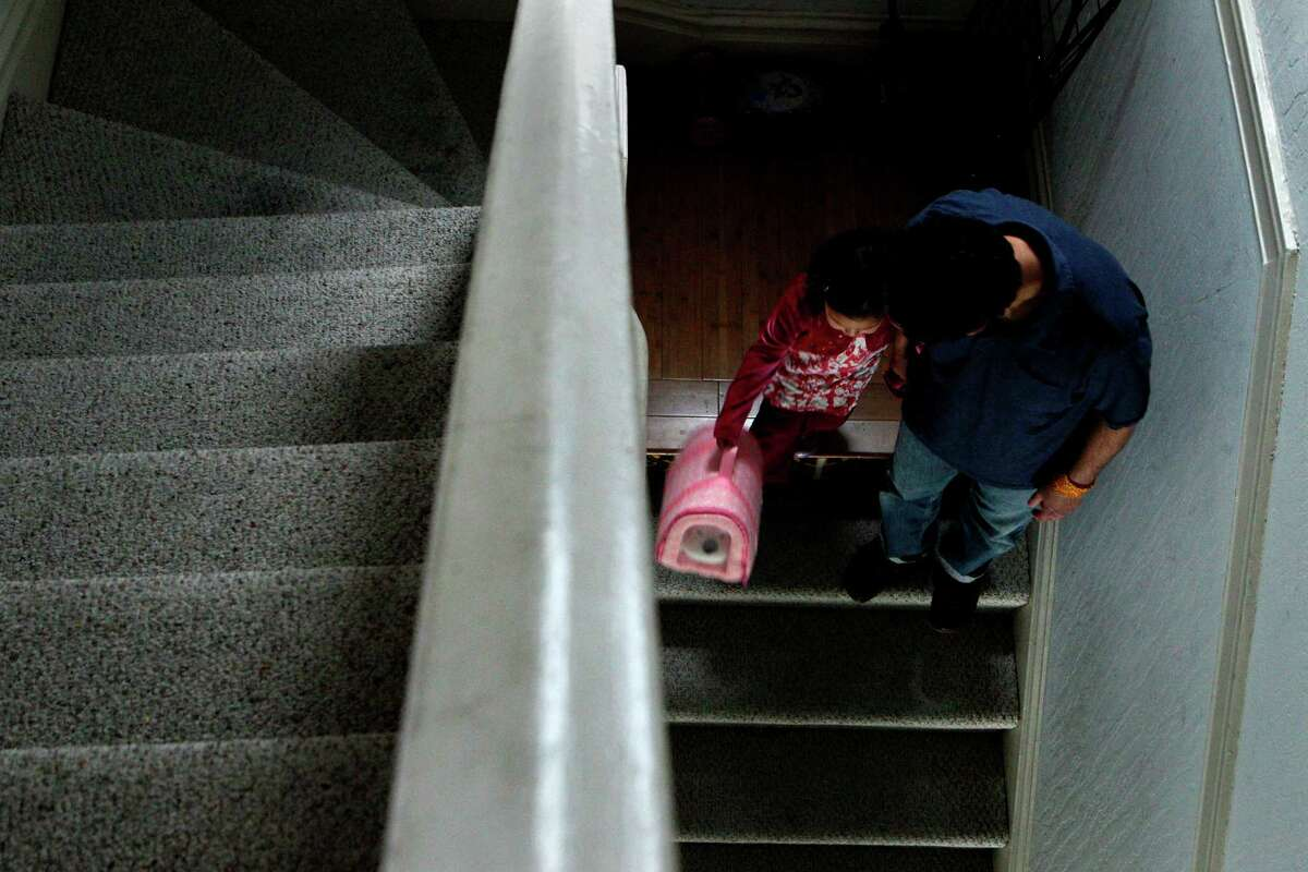 Camila Lopez-Salazar, age 3, and her father Ariel Lopez, head out of their apartment in the Mission neighborhood, Friday, April 3, 2015, in San Francisco, Calif. The family narrowly avoided eviction and fear that they could be in the future. S.F. supervisor David Campos has floated the idea of imposing a temporary moratorium on new development in a roughly 10 square block area in the Mission district. The idea is to halt new development until the city can develop a comprehensive plan about how to deal with the housing crisis that has removed longtime residents from their homes.