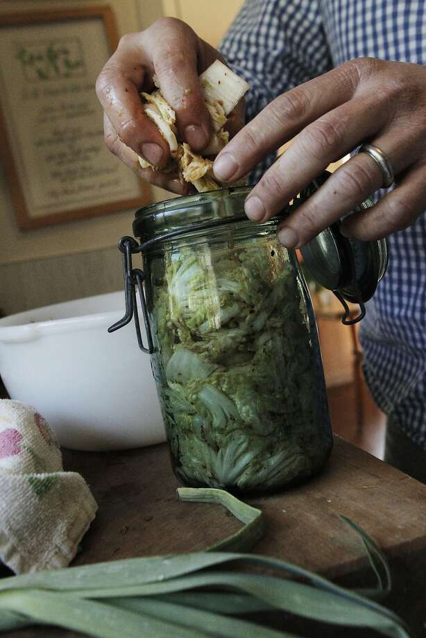 After Russell Moore tosses and mixes all of the ingredients in a bowl, then he squishes the mixture into a jar and lets it ferment for a few days in his home in Richmond, Calif., Thursday April 2, 2015. Photo: Sophia Germer, The Chronicle