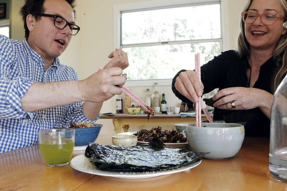 Russell Moore and Allison Hopelain enjoy a family style Korean meal at their home in Richmond, Calif., Thursday April 2, 2015. Photo: Sophia Germer, The Chronicle