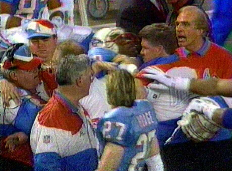 """Kevin Gilbride will be selling insurance in two years.""- A couple days after he infamously punched Houston Oilers offensive coordinator Kevin Gilbride for not running out the clock at the end of the first half of a game. Photo: ESPN"