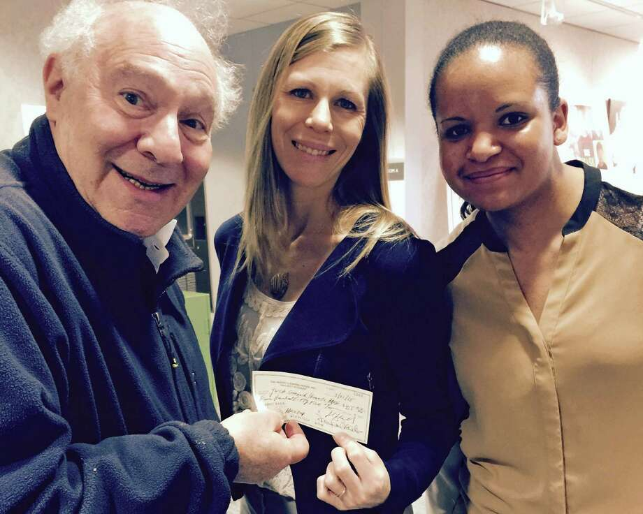 Joe Kaliko, co-president of the Needs Clearing House, presents a check to Vanessa Wilson, left, and Jessie DiMuzio of the Greenwich YWCA to support the Y's domestic abuse services. Photo: Contributed Photo / Greenwich Time Contributed