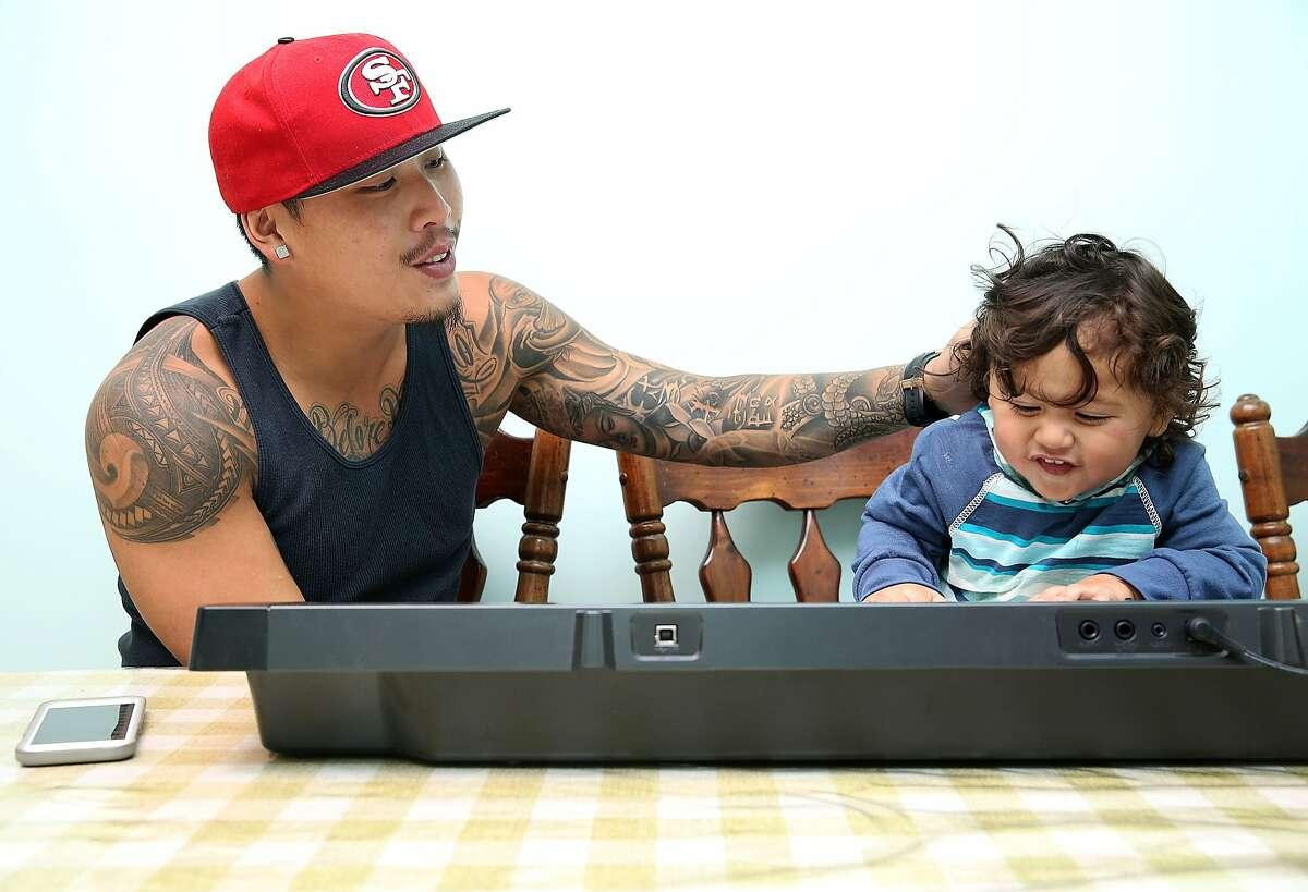 Kevin Yip playing with his 22 month old son, Dominic King Yip at his parents' home where he grew up in San Bruno, California, on Friday, April 3, 2015.