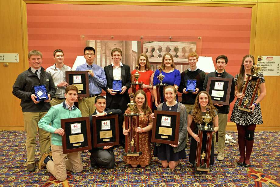 Greenwich High School band students show off the awards they won at the WorldStrides Heritage Performance Festival in Washington, D.C. Photo: Contributed Photo / Greenwich Time Contributed