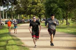 People jog along the Seymour Lieberman Trail at Memorial Park  in Houston. ( Brett Coomer / Houston Chronicle )