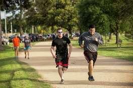 People jog along the Seymour Lieberman Trail at Memorial Park in Houston. ( Brett Coomer / Houston Chronicle )