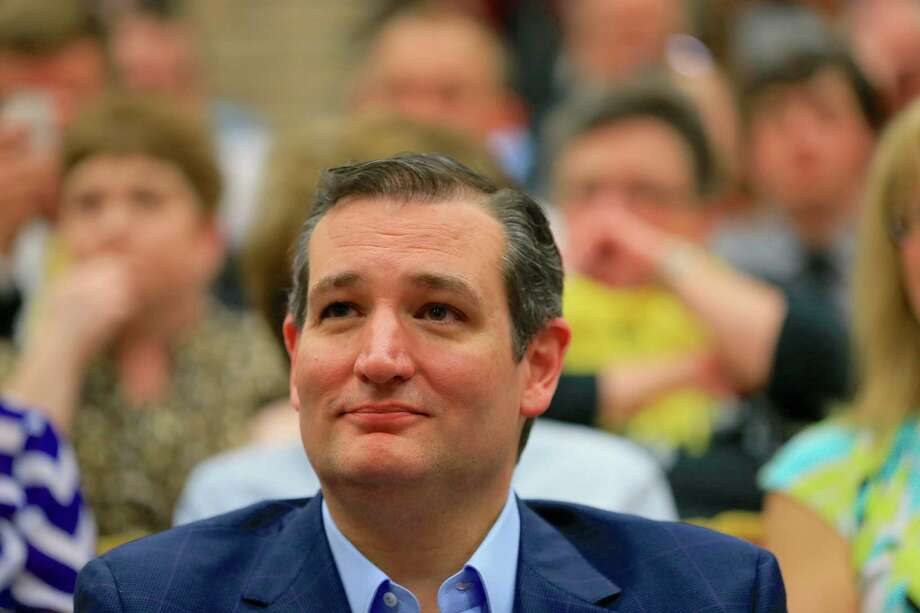 Presidential candidate Sen. Ted Cruz, R-Texas, sits in the front row as he waits to be introduced at a town hall event at Morningside College in Sioux City, Iowa, Wednesday, April 1, 2015. (AP Photo/Nati Harnik) Photo: Nati Harnik, STF / Associated Press / AP