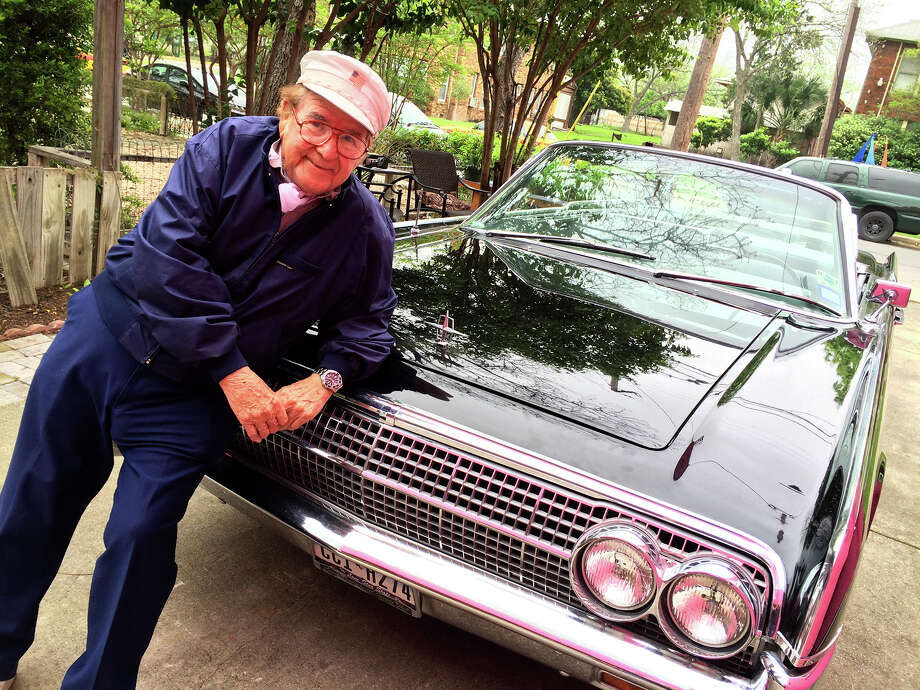 San Antonio musician Fernando Herrera poses with the 1963 Lincoln Continental that John F. Kennedy rode in during his visit to the city the day before his assassination in Dallas. Herrera was the last musician to ever perform for Kennedy. Photo: Rene A. Guzman /San Antonio Express-News / San Antonio Express-News