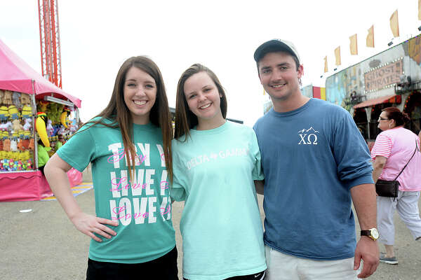 Siblings Kaleigh, Rachel, and Coldy Decordova of Conroe take in the midway at the YMBL South Texas State Fair Friday. The fair opened early to accommodate the larger crowds anticipated on the Good Friday holiday. Photo taken Friday, April 3, 2015 Kim Brent/The Enterprise