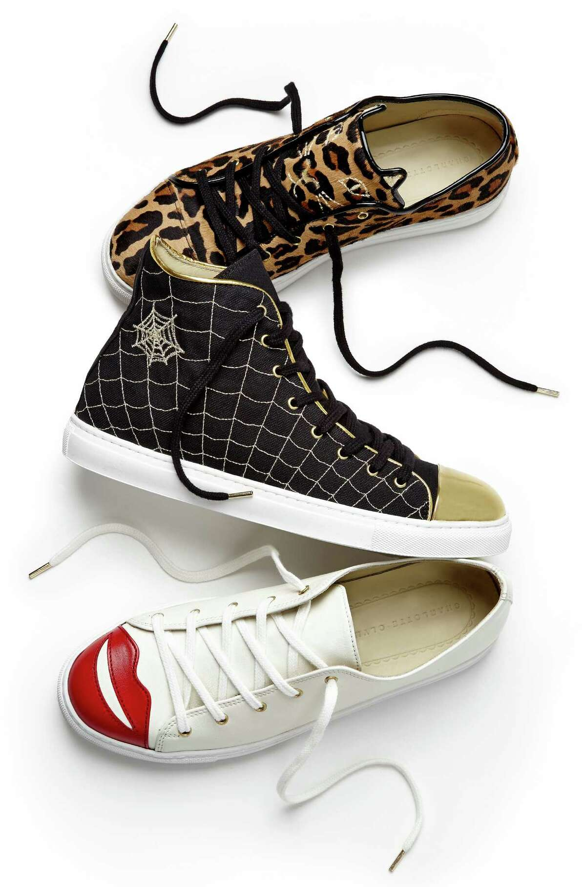 From top: low-top Purrrfect Sneakers, Web High-Tops in black canvas with gold leather toe cap, Kiss Me Sneakers in off-white nappa leather.
