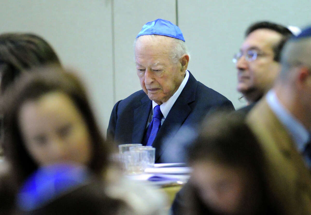 Arthur Morris of Rye Brook, N.Y., prays during the Sholom Center Passover Seder at Temple Sholom in Greenwich, Conn., Friday night, April 3, 2015.