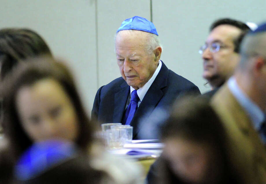 Arthur Morris of Rye Brook, N.Y., prays during the Sholom Center Passover Seder at Temple Sholom in Greenwich, Conn., Friday night, April 3, 2015. Photo: Bob Luckey / Greenwich Time
