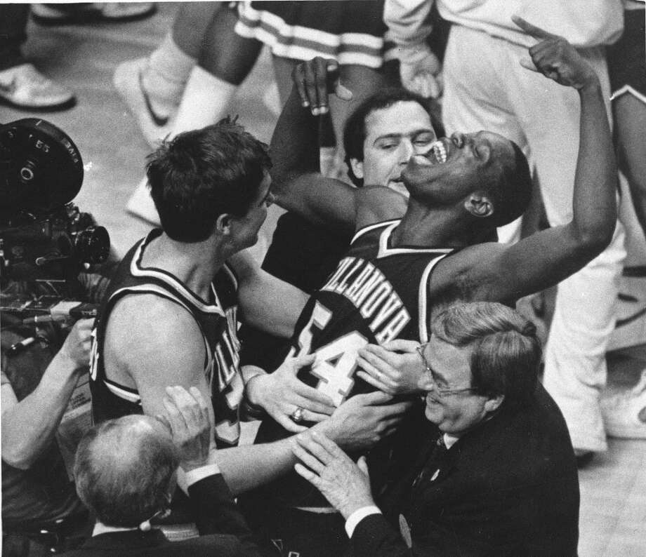 10. 1985 at Lexington, Ky.: Georgetown (1), St. John's (1), Memphis State (2), Villanova (8)This was a historic Final Four for many reasons. First, it's the only one to feature three teams from the same conference, as Memphis State was the outsider during the heyday of the Big East. Plus, the shocking ending - Villanova's 66-64 victory over defending national champion and top-ranked Georgetown - is considered one of the greatest upsets in sports history, although the Wildcats did play the Hoyas close in dropping both regular-season meetings. The Villanova/Georgetown final also was the last college basketball game played without a shot clock. Photo: GARY LANDERS, ASSOCIATED PRESS