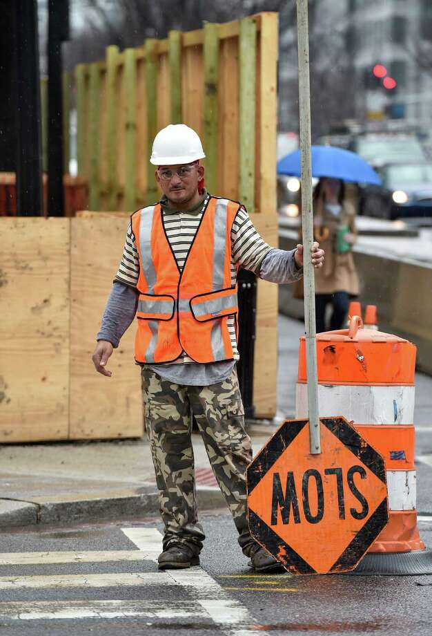 A worker stands with a sign at a construction site in Washington, D.C. The U.S. economy produced a disappointing 126,000 jobs in March, half of what was expected and the worst month since December 2013, the Labor Department reported. Photo: Nicholas Kamm /AFP / Getty Images / Nicholas Kamm/AFP