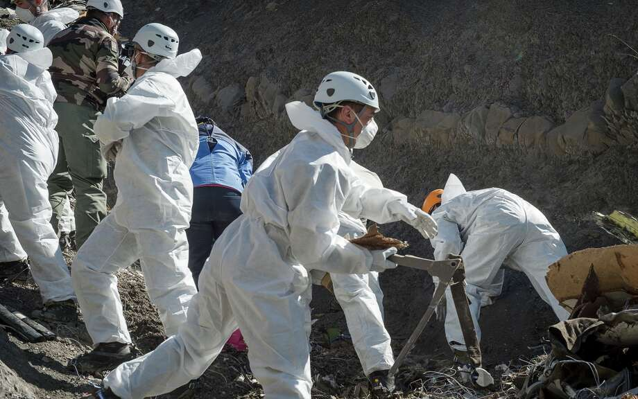 In this photo provided Friday April 3, 2015 by the French Interior Ministry, French emergency rescue services work among debris of the Germanwings passenger jet at the crash site near Seyne-les-Alpes, France. The co-pilot of the doomed Germanwings flight repeatedly sped up the plane as he used the automatic pilot to descend the A320 into the Alps, the French air accident investigation agency said Friday. (AP Photo/Yves Malenfer, Ministere de l'Interieur) Photo: Yves Malenfer, HOPD / Minsitere de l'Interieur