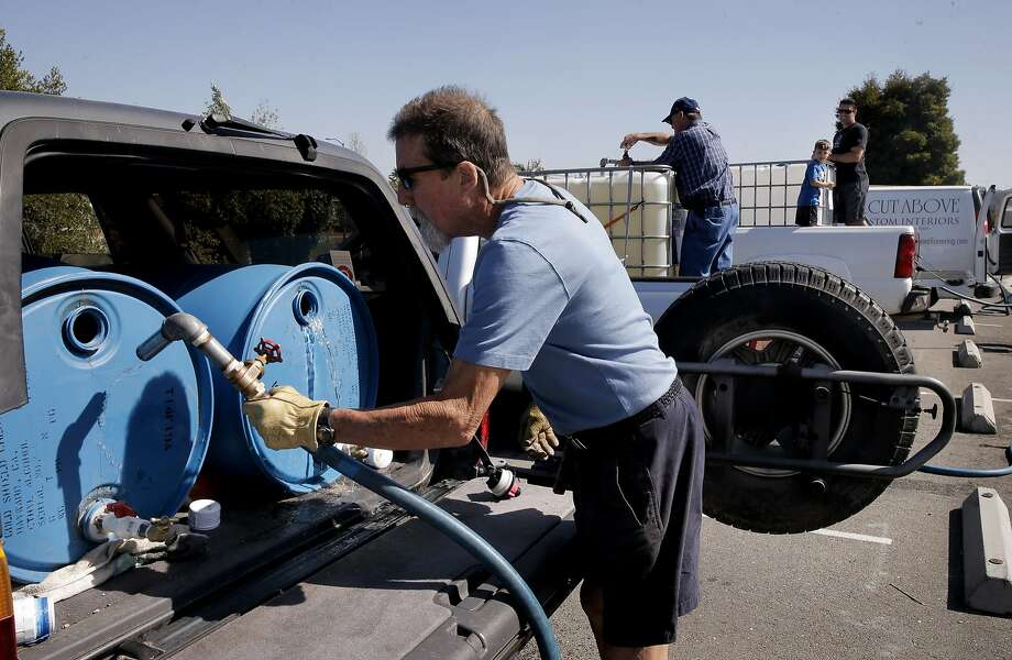 Steve London joins a line of vehicles as they fill their containers with recycled water at the Dublin San Ramon Services District Recycled Water Plant in Pleasanton, Calif., as seen on Fri. April 3, 2015. Photo: Michael Macor, The Chronicle