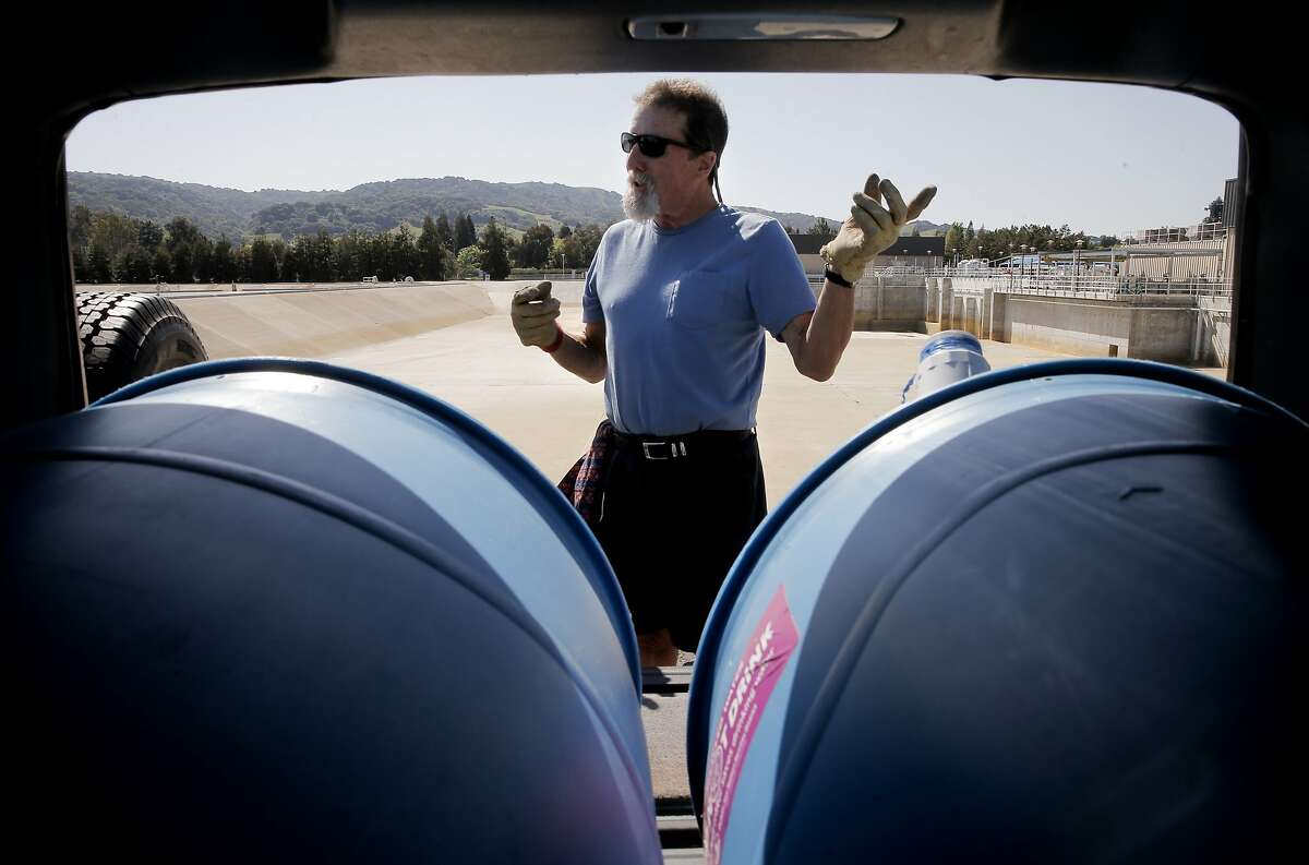 Steve London fills his two fifty five gallon containers in the back of his hatchback with recycled water at the Dublin San Ramon Services District Recycled Water Plant in Pleasanton, Calif., as seen on Fri. April 3, 2015.