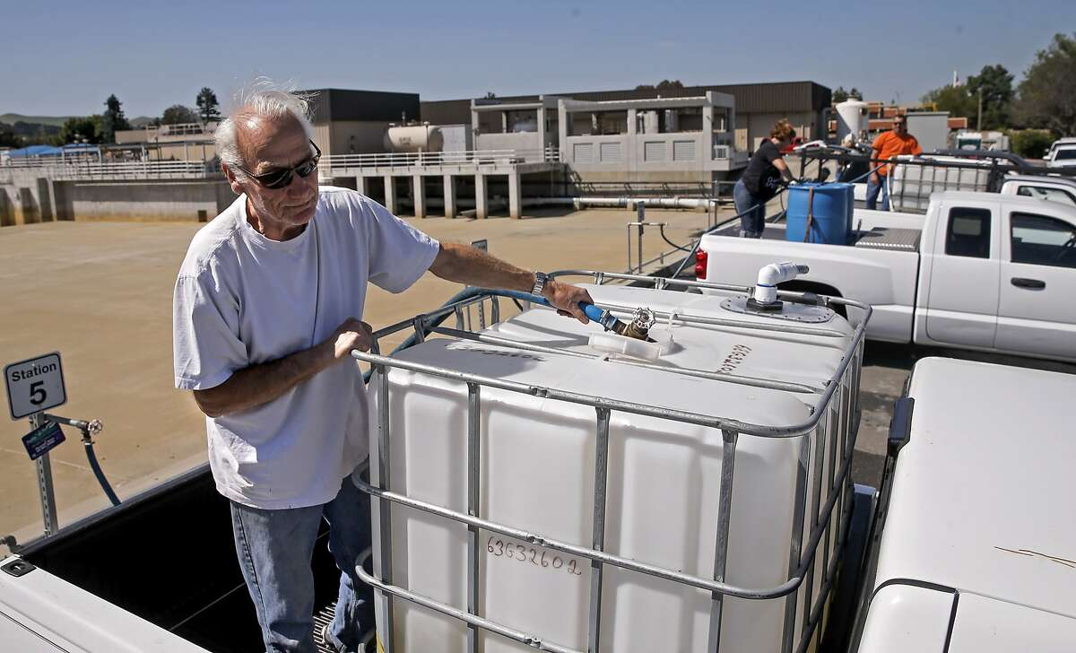 Mike Hemus, joins a line of vehicles as he fills his two hundred and seventy five gallon container with recycled water at the Dublin San Ramon Services District Recycled Water Plant in Pleasanton, Calif., as seen on Fri. April 3, 2015.