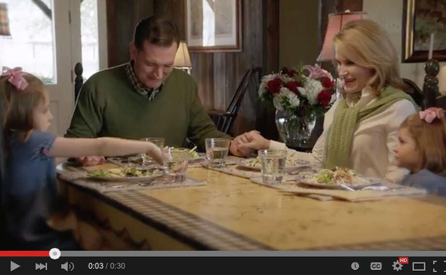 "Texas Sen. Ted Cruz's first television campaign ad includes an image of his family saying grace at the dinner table. It also tells the story of Christ's ""transforma-tive"" power to return his father to the  family. Photo: YouTube.com / YouTube.com"