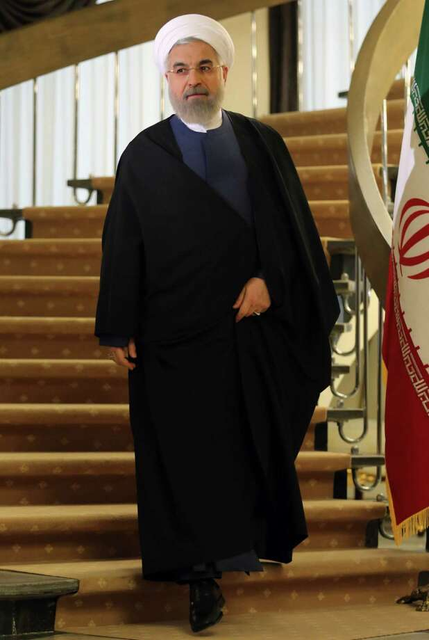 "Iranian President Hassan Rouhani arrives to speak during a press conference in Tehran on April 3, 2015. Iran vowed to stand by a nuclear deal with world powers as Rouhani promised it would open a ""new page"" in the country's global ties.  AFP PHOTO/ATTA KENAREATTA KENARE/AFP/Getty Images Photo: ATTA KENARE, Staff / AFP / Getty Images / AFP"