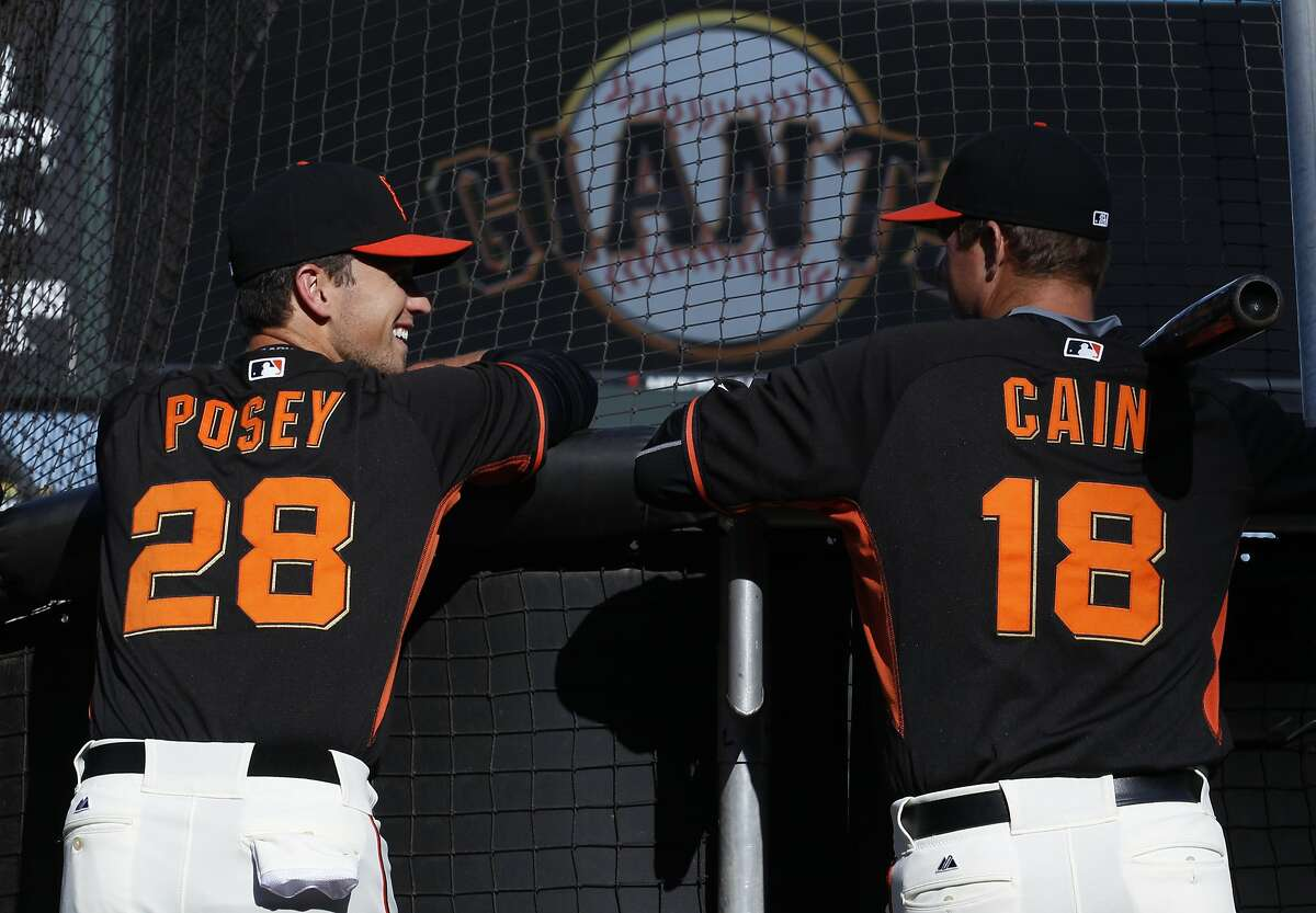 San Francisco Giants' Buster Posey, left, and pitcher Matt Cain chat before their baseball game against the Oakland Athletics on Friday, April 3, 2015 in San Francisco, Calif.