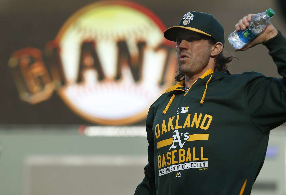 Oakland Athletics pitcher Barry Zito warms up before his baseball game against the San Francisco Giants on Friday, April 3, 2015 in San Francisco, Calif.