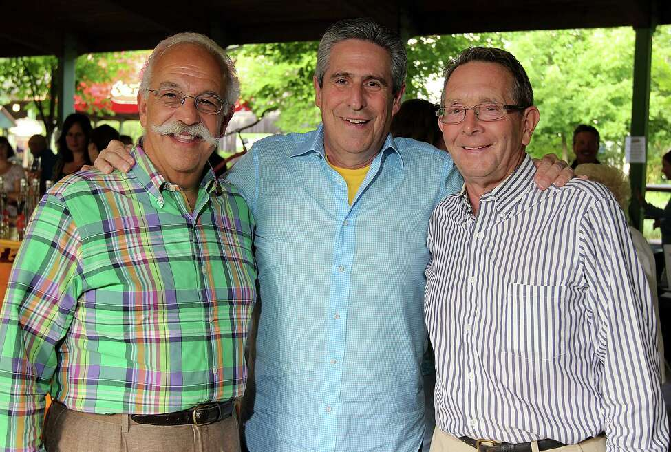 Event auctioneer and restaurateur LeGrande Serras, left, poses in 2013 with Richard Yulman, center, and Peter Sherman during the 22nd Annual Double H Ranch Gala in Lake George. Yulman recalled Donald