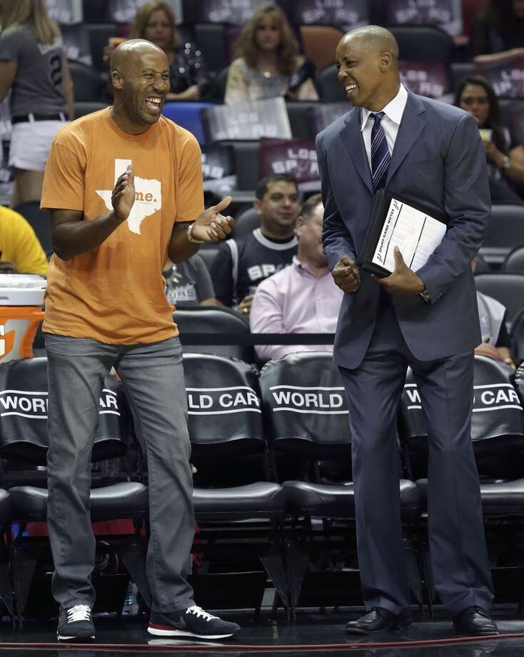 Bruce Bowen and Sean Elliott  enjoy the pre game as the Spurs host Denver at the AT&T Center on April 3, 2015. Photo: San Antonio Express-News