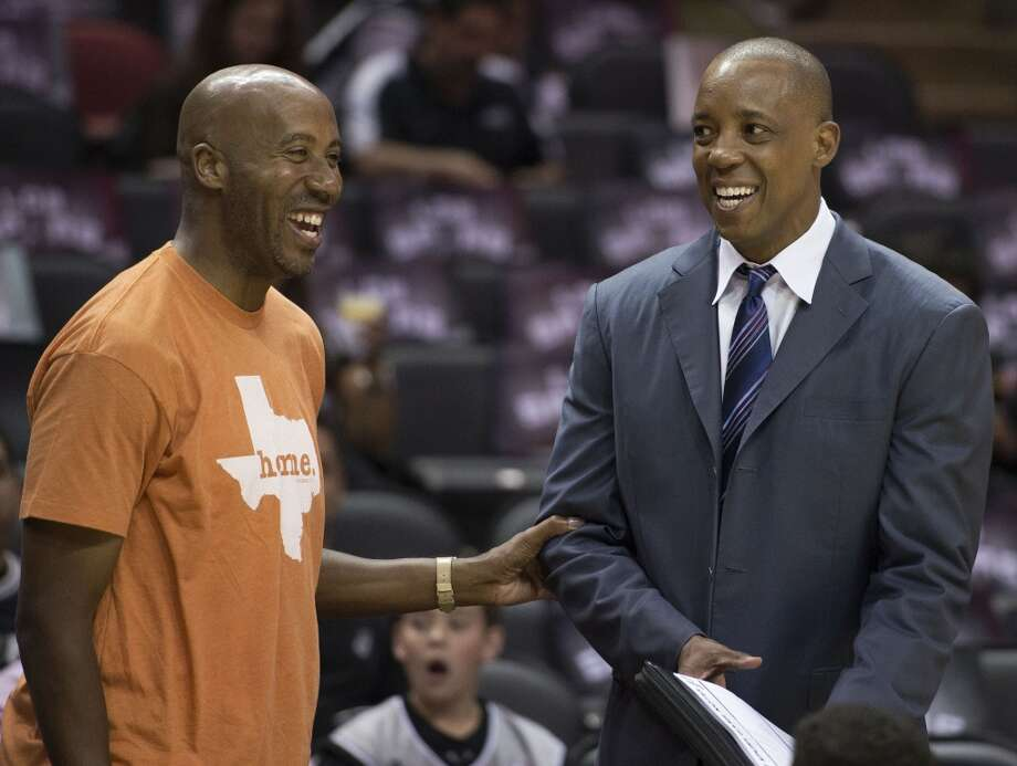 """As part of a new video series called """"Spurs Voices,"""" former San Antonio Spurs player Sean Elliott shared a message about a time when he was called a racial slur while golfing with former teammate Bruce Bowen in San Antonio. In the photo, Bowen, left, and Sean Elliott speak before an NBA game against the Denver Nuggets on Friday, April 3, 2015, in San Antonio. Photo: Associated Press"""