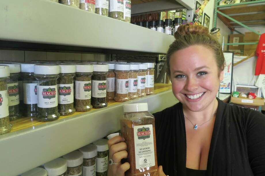 Concetta Maceo, who manages the family business, moved back to Galveston last year to go to nursing school but realized spices were her passion. Photo: Joe Holley / Houston Chronicle
