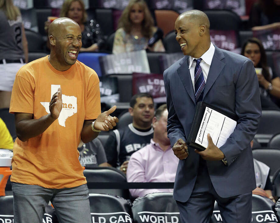 Bruce Bowen and Sean Elliott  enjoy the pre game as the Spurs host Denver at the AT&T Center on April 3, 2015. Photo: Tom Reel / San Antonio Express-News