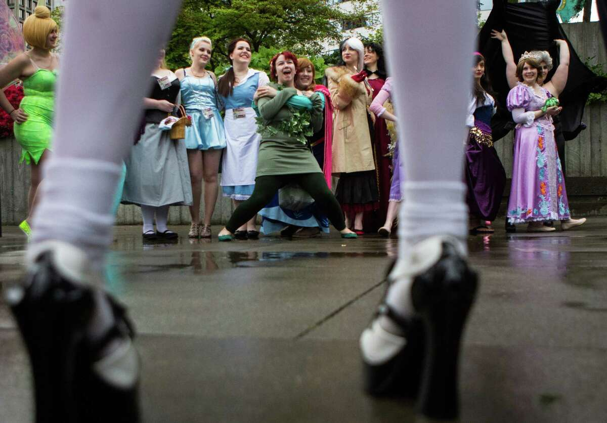 Disney characters pose together during day one of Sakura-Con, a convention celebrating Japanese animation and culture, at the Washington State Convention Center on Friday, April 3, 2015.