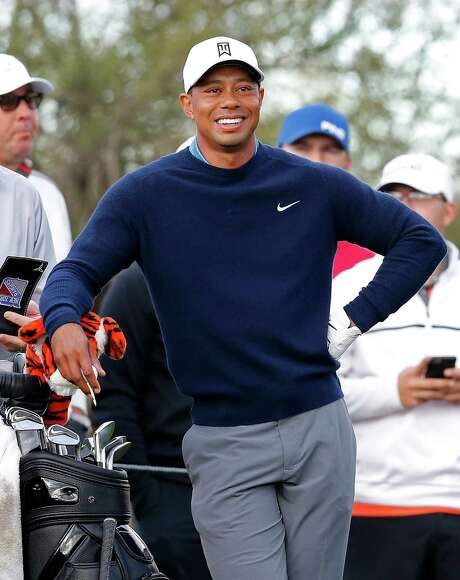 """FILE - In this Jan. 27, 2015, file photo, Tiger Woods waits on the ninth tee box during a practice round for to the Phoenix Open golf tournament in Scottsdale, Ariz. Tiger Woods has made up his mind _ he will play the Masters. After two trips to Augusta National this week, Woods announced his return to competition on his website Friday, April 3, 2015. He wrote: """"I'm playing the Masters. It's obviously very important to me, and I want to be there."""" (AP Photo/Rick Scuteri, File) Photo: Rick Scuteri, FRE / FR157181 AP"""