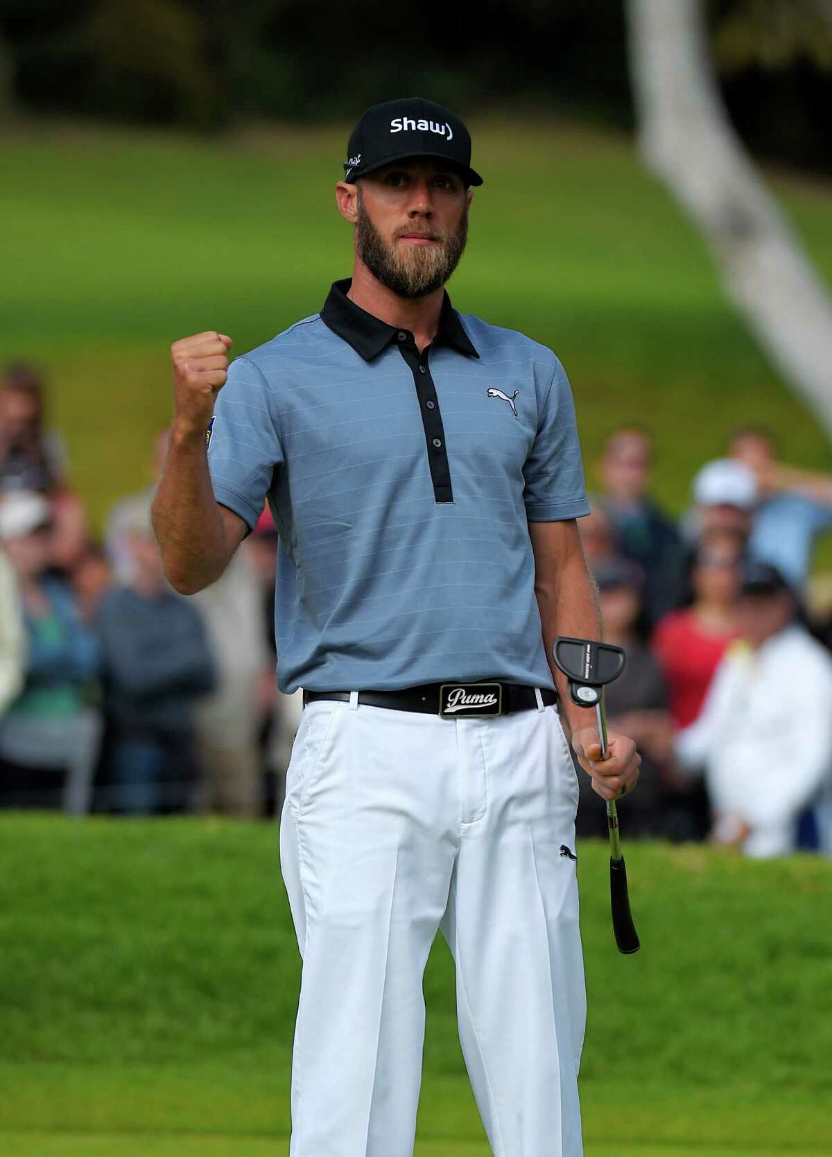 Graham DeLaet reacts after sinking a birdie putt on the 16th hole during the third round of the Northern Trust Open golf tournament at Riviera Country Club, Saturday, Feb. 21, 2015, in Los Angeles. (AP Photo/Mark J. Terrill)