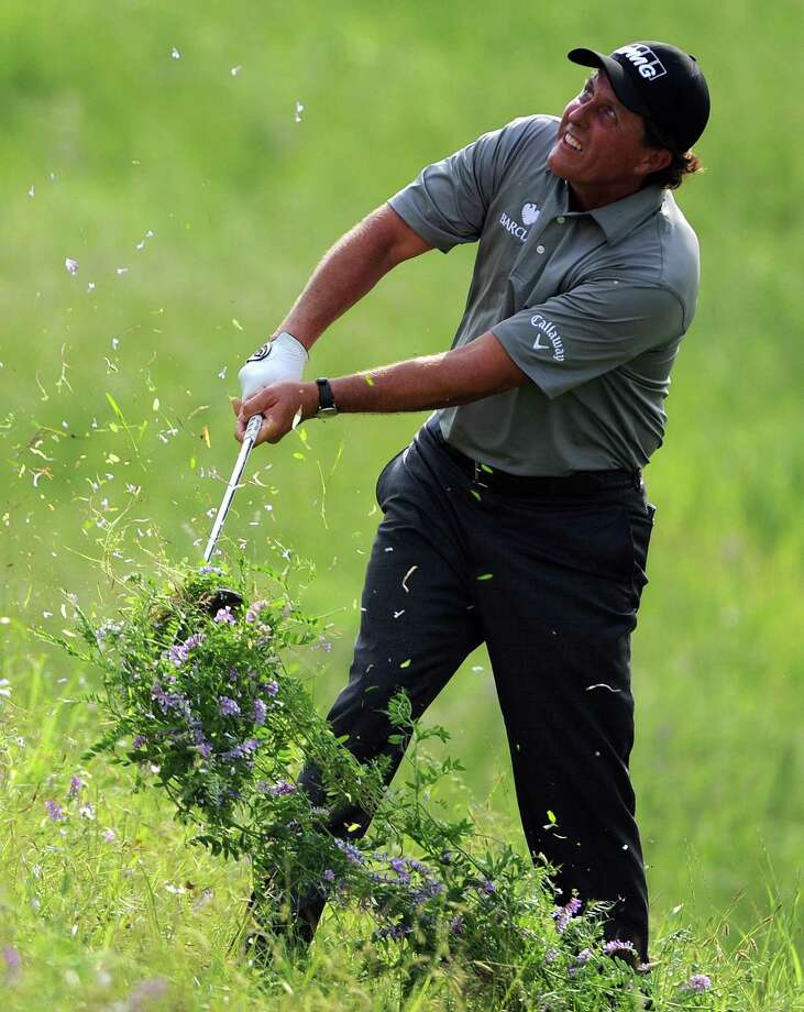 Phil Mickelson digs up some Texas turf after finding the rough on No. 17, well, rough. His second-round 67 on Friday earned him a share of second place in the Shell Houston Open. Photo: Eric Christian Smith, Freelance / 2015 Eric Christian Smith
