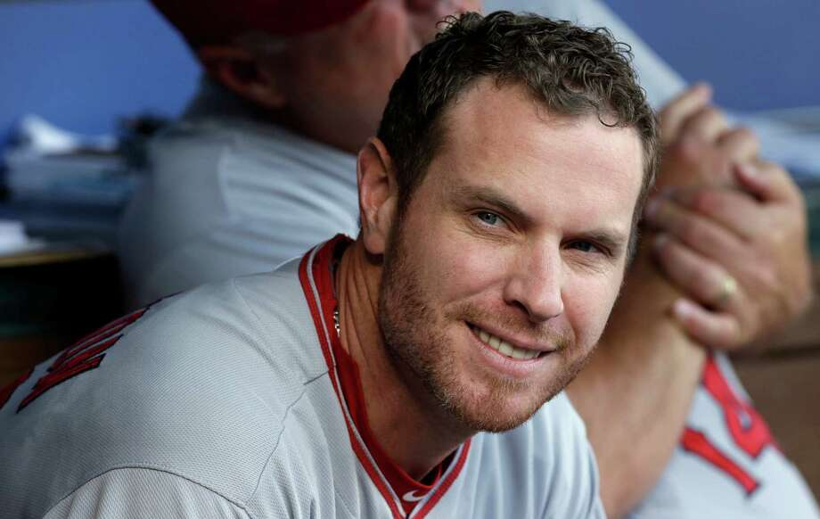 FILE - This July 12, 2014, file photo shows Los Angeles Angels' Josh Hamilton in the dugout during a baseball game against the Texas Rangers in Arlington, Texas. An arbitrator has ruled Josh Hamilton will not be disciplined by Major League Baseball for violating his treatment program. MLB said Friday, April 3, 2015,  it disagreed with the decision. (AP Photo/LM Otero, File) Photo: LM Otero, STF / AP