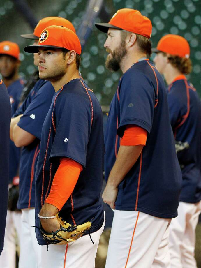 Astros pitching prospect Lance McCullers Jr., left, takes in batting practice Friday at Minute Maid Park while his father and former major leaguer, Lance Sr., looks on proudly from the stands. Photo: Karen Warren, Staff / © 2015 Houston Chronicle