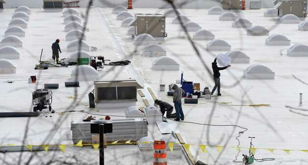 Workers on the roof of the new WalMart under construction at the former Latham Circle Mall Tuesday March 31, 2015, in Colonie, NY.  (John Carl D'Annibale / Times Union) Photo: John Carl D'Annibale / 00031226A